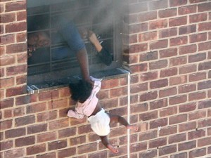 baby_hanging_out_window